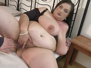 Fat dam Stefanka C. uses her mouth to make his cock disappear