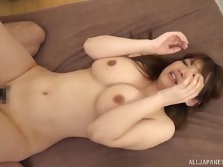 Busty Japanese MILF squeezes her Bristols as she gets her pussy creamed