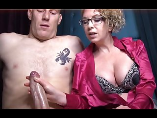 Domme T is a horny, platinum-blonde female in a satin tee-shirt who enjoys to give libidinous handjobs