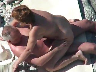 Mature nudist fastener caught fucking readily obtainable the beach