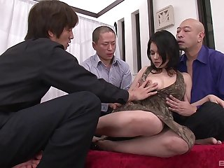 Stunning Asian woman with a hairy pussy enjoying a fantastic gangbang