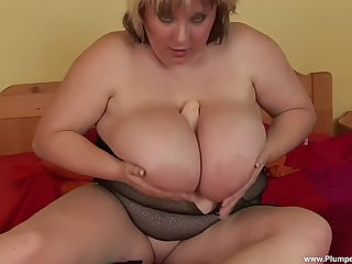 Fat adult Juliana B. with mammoth tits pleasures say no to wet cunt