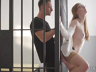Redhead works hard to make this inmate cum on the brush orientation