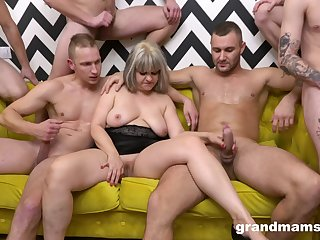 A stable of blokes get it on with a big-busted matured pro